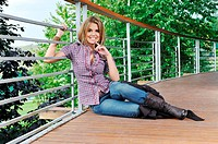 young woman posing in fashion business and caual clothing outdoor