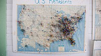 Map of the United States with visitor push pins marking home towns.