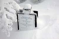 Alpine zone sign covered in snow on the Ammonoosuc Ravine Trail during the winter months...Located in the White Mountains, New Hampshire USA