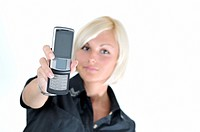 portrait of young blonde business woman holding new modern cellphone