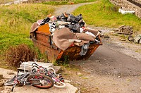 A rubbish skip and junk in the Uk