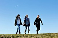 group of teen people woman have fun outdoor with blue sky in background