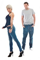 young couple isolated on white in fashionable underwear and blue jeans clothing