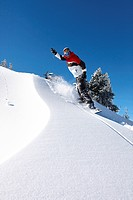 Snowboarder gliding down a slope