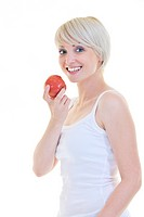 happy young woman eat green apple isolated on white backround in studio