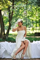 beautiful bride woman people in fashion wedding dress posing outdoor in bright park