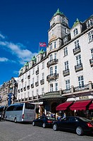Cars in front of Grand Hotel along Karl Johans Gate street Sentrum central Oslo Norway Europe
