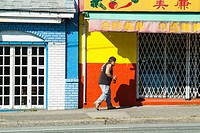a man walks on East Hastings Street, in Vancouver, BC, Canada