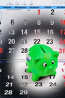 Piggy Bank on Calendar Pages