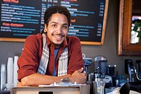 Mixed race man working in coffee shop