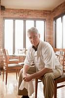 Caucasian chef sitting in restaurant