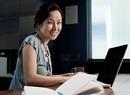 Japanese businesswoman using laptop