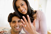 Mixed race woman showing off engagement ring