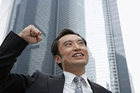 Close up of businessman cheering