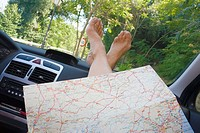 Map resting on woman´s legs