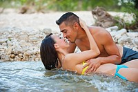 USA, Texas, Leakey, Young couple romancing at Frio River