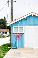France, Light blue fisher hut at Atlantic coast