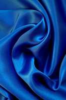 Smooth elegant blue silk as background
