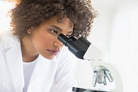 Woman using microscope in laboratory