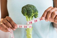 Woman measuring broccoli
