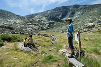 Hikers restiing in Navamediana Valley, Sierra de Gredos Regional Park  Ávila province  Castilla y León  Spain