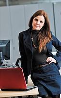 business woman in suit portrait in modern office