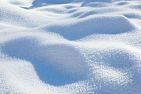 Sunlight and shadow on snow