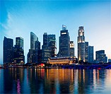 Singapore skyline and Marina Bay in evening