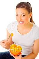 Young girl eat fruit salad isolated
