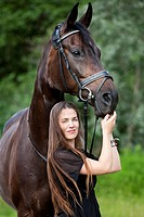 Young woman standing with a Hanoverian horse, bay, North Tyrol, Austria, Europe