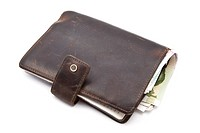 Brown wallet with currency