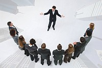 CEO leads motivational employee meeting