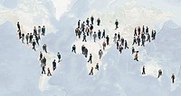 Large group of businesspeople walking on world map