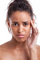 Portrait of young Mixed Race woman suffering from headache against white background
