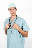 Close_up portrait of young doctor wearing scrubs and standing proudly
