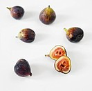 Fresh Figs on White, One Halved