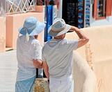 Couple of tourists, Oia, Santorini, Greece