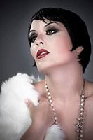 gourgeos brunette flapper wearing pearls and fur