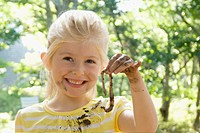 Caucasian girl holding worm