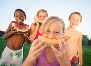 Children eating cantaloupe and watermelon