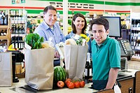 Customers and cashier in grocery store