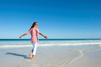 Mature woman feeling free at beach