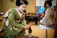 Fukukimi,´maiko´ geisha apprentice workimg in Miyaki tea house o-chaia Geisha´s distric of Miyagawacho Kyoto  Kansai, Japan