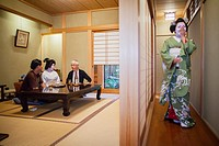 Fukuyu,geisha and Fukukimi,'maiko' geisha apprentice workimg in Miyaki tea house o-chaia Geisha's distric of Miyagawacho Kyoto  Kansai, Japan