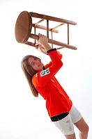 Teen girl holding stool