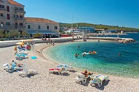 Tourists relaxing in Postira village on Brac island, Croatia