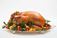 Stuffed roast turkey with vegetables and herbs
