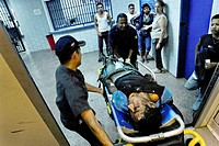 Venezuelan first aid squad transport a drug overdosed patient into the state hospital in Caracas, Venezuela, 25 June 2006