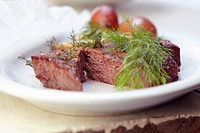 Steak with Fresh Dill and Potato on a White Plate