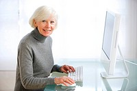 Senior woman using computer.